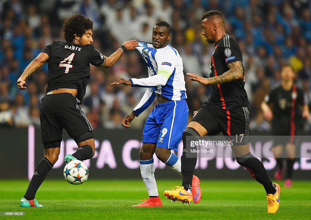 Jackson Martinez of FC Porto battles with Dante (4) and <a gi-track='captionPersonalityLinkClicked' href=/galleries/search?phrase=Jerome+Boateng&family=editorial&specificpeople=2192287 ng-click='$event.stopPropagation()'>Jerome Boateng</a> of Bayern Muenchen (17) during the UEFA Champions League Quarter Final first leg match between FC Porto and FC Bayern Muenchen at Estadio do Dragao on April 15, 2015 in Porto, Portugal.