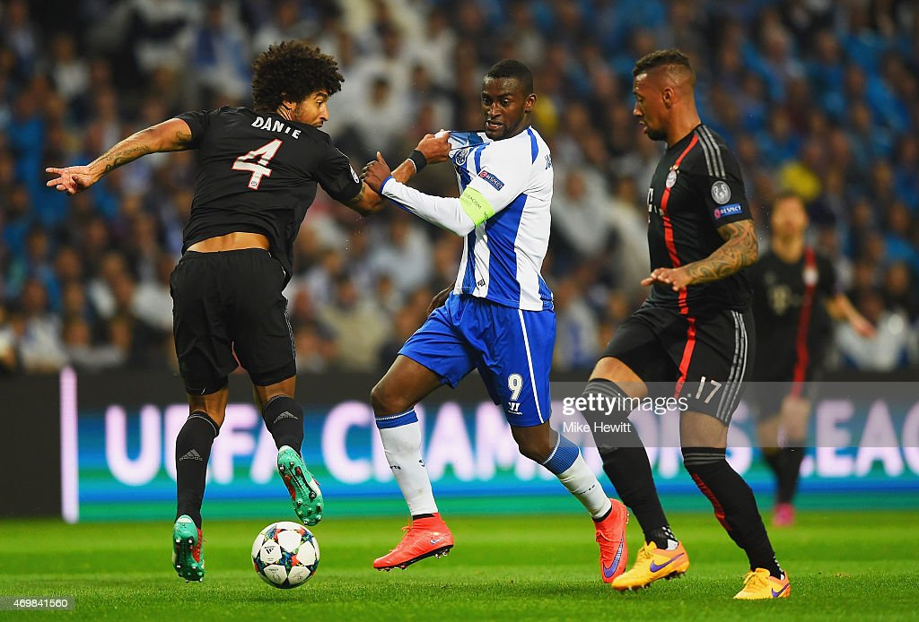 Jackson Martinez of FC Porto battles with Dante and Jerome Boateng of Bayern Muenchen during the UEFA Champions League Quarter Final first leg match...