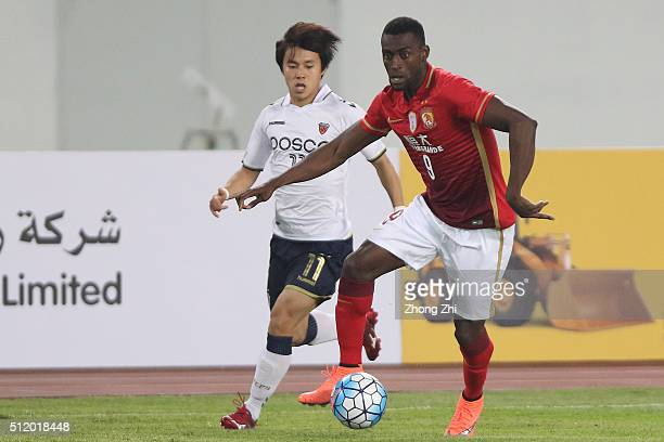 Jackson Martinez of Guangzhou Evergrande in action against Shim Dongwoon of Pohang Steelers during AFC Champions League Group H match between...