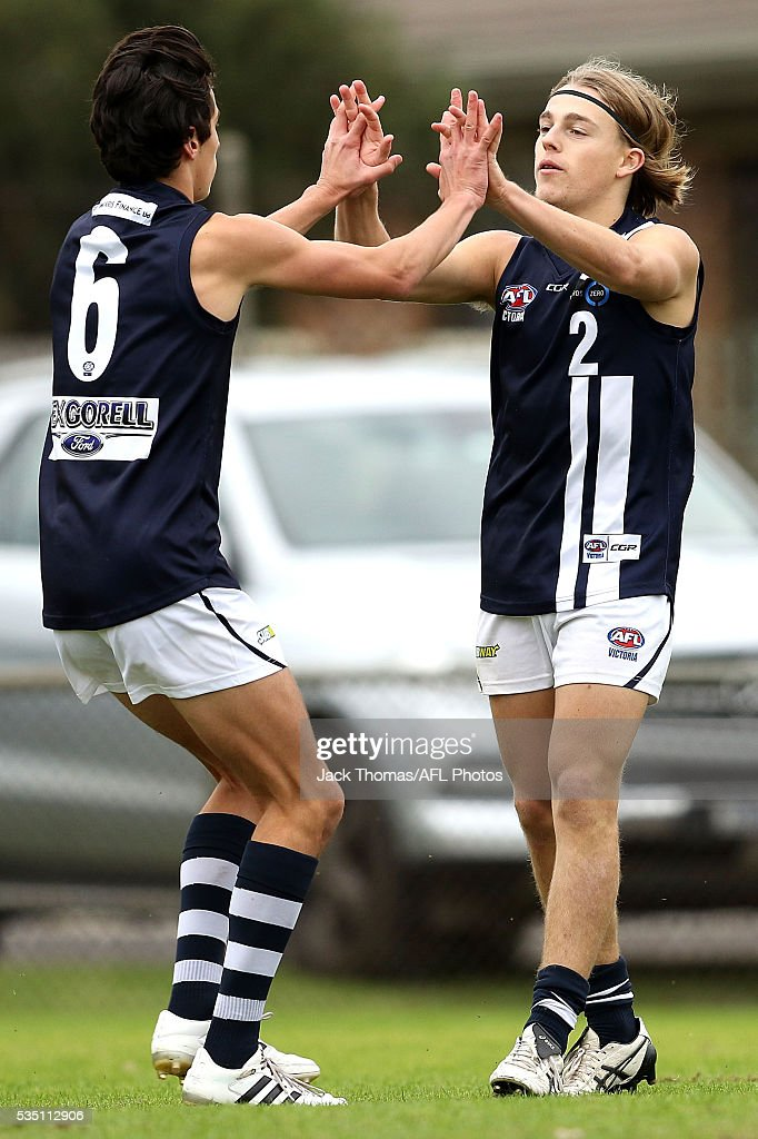 Jackson McLachlan of the Geelong Falcons (L) celebrates a goal with team mate Sam Simpson of the Geelong Falcons during the round eight TAC Cup match between Dandenong Stingrays and Geelong Falcons at Shepley Oval on May 29, 2016 in Melbourne, Australia.