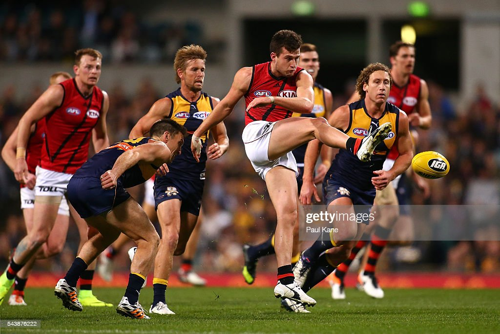 Jackson Merrett of the Bombers clears the ball during the round 15 AFL match between the West Coast Eagles and the Essendon Bombers at Domain Stadium on June 30, 2016 in Perth, Australia.