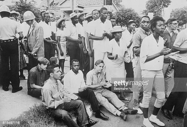 Negro leader John Lewis head of the Student Nonviolent Coordinating Committee was among a small group of racial demonstrators who staged a temporary...