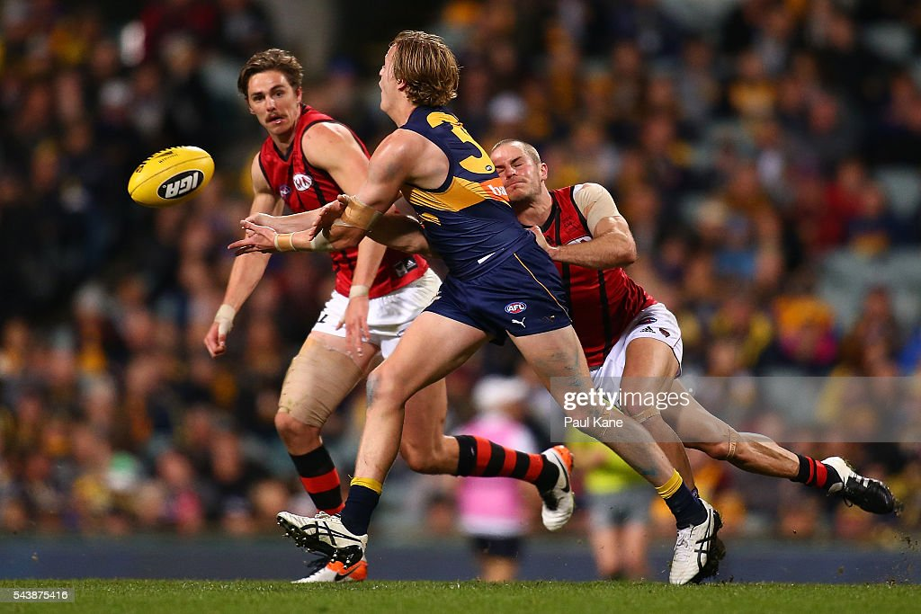 Jackson Nelson of the Eagles handballs during the round 15 AFL match between the West Coast Eagles and the Essendon Bombers at Domain Stadium on June 30, 2016 in Perth, Australia.