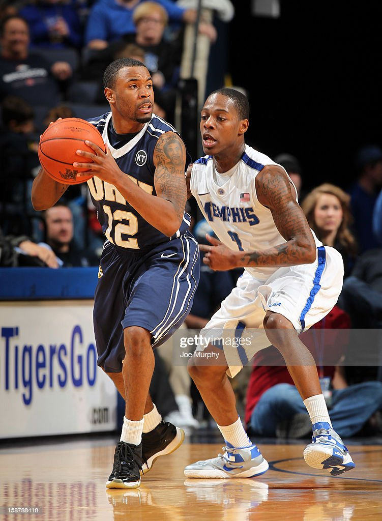 D.J. Jackson #12 of the Oral Roberts Golden Eagles looks to pass against Antonio Barton #2 of the Memphis Tigers on December 28, 2012 at FedExForum in Memphis, Tennessee.