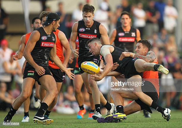 Jackson Ramsay is tackled during the Collingwood Magpies AFL IntraClub match at Olympic Park on February 19 2015 in Melbourne Australia