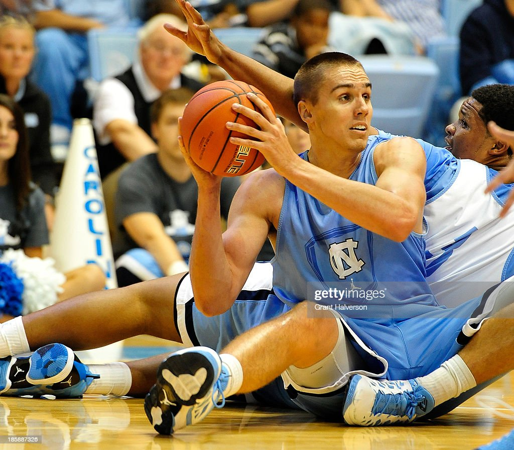 Jackson Simmons #41 of the North Carolina Tar Heels wins the battle for a loose ball with teammate Kennedy Meeks #3 during Late Night with Roy Williams at the Dean Smith Center on October 25, 2013 in Chapel Hill, North Carolina.