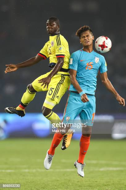 Jackson Singh Thounaojam of India and Gustavo Carvajal of Colombia battle for the ball during the FIFA U17 World Cup India 2017 group A match between...