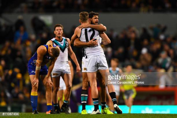 Jackson Trengove and Paddy Ryder of the Power celebrate the win on there final siren during the 2017 AFL round 16 match between the West Coast Eagles...