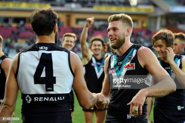 Jackson Trengove is congratulated by Patrick Ryder of the Power after the round 17 AFL match between the Port Adelaide Power and the North Melbourne...