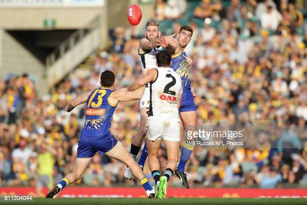 Jackson Trengove of the Power contests a ruck with Scott Lycett of the Eagles during the round 16 AFL match between the West Coast Eagles and the...