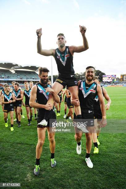 Jackson Trengove of the Power is chaired from the ground by Justin Westhoff and Charlie Dixon of the Power after defeating the Kangaroos during the...