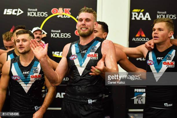 Jackson Trengove of the Power sings the club song after the round 17 AFL match between the Port Adelaide Power and the North Melbourne Kangaroos at...