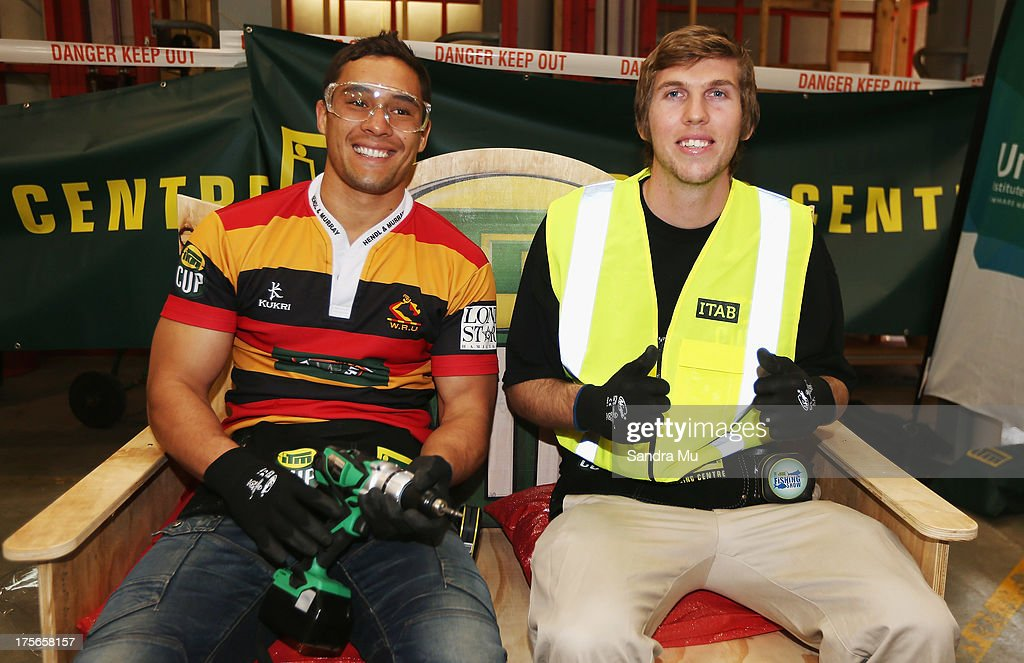 Jackson Willison of Waikato and his apprentice Jason Walters (R) complete the challenge during the 2013 launch of the ITM Cup at Unitec on August 6, 2013 in Auckland, New Zealand.