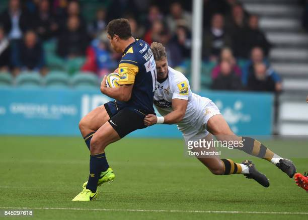 Jackson Willison of Worcester Warriors is tackled by Josh Bassett of Wasps during the Aviva Premiership match between Worcester Warriors and Wasps at...