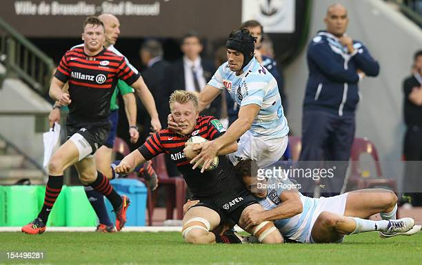 Jackson Wray of Saracens is tackled by Olly Barkley and Antoine Battut during the Heineken Cup match between Saracens and Racing Metro at King...