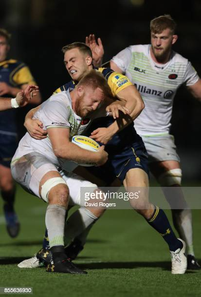 Jackson Wray of Saracens is tackled by Perry Humphreys during the Aviva Premiership match between Worcester Warriors and Saracens at Sixways Stadium...