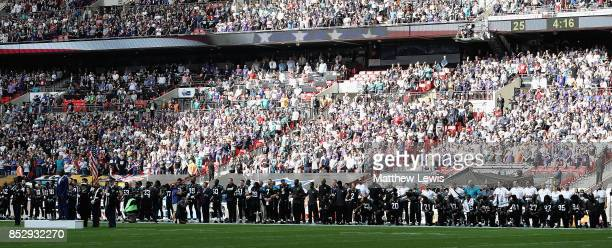 Jacksonville Jaguar players show their protest during the National Anthem during the NFL International Series match between Baltimore Ravens and...