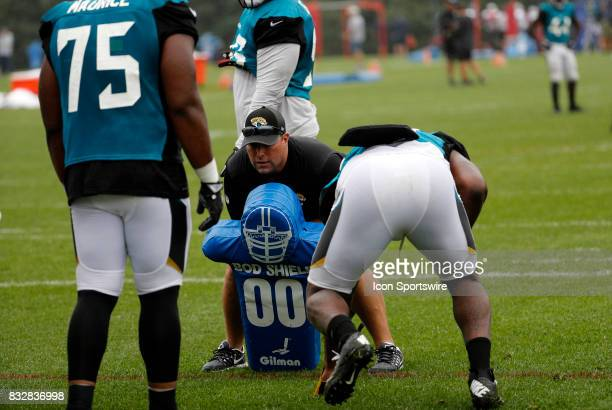 Jacksonville Jaguars assistant defensive line coach Jason Rebrovich gets ready for a drill during a joint New England Patriots and Jacksonville...