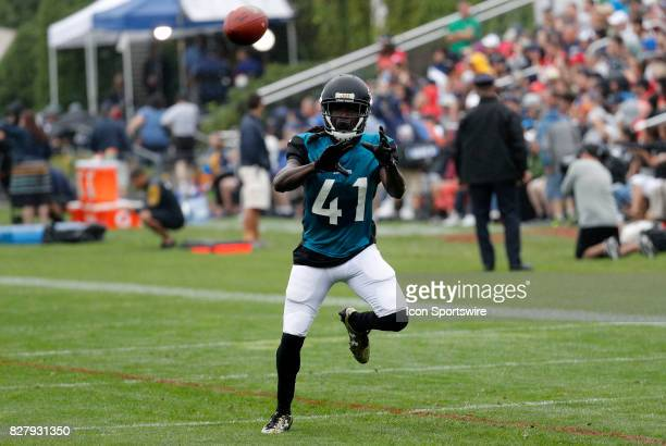 Jacksonville Jaguars cornerback Brian Dixon eyes a grab during a joint New England Patriots and Jacksonville Jaguars training camp on August 8 at...