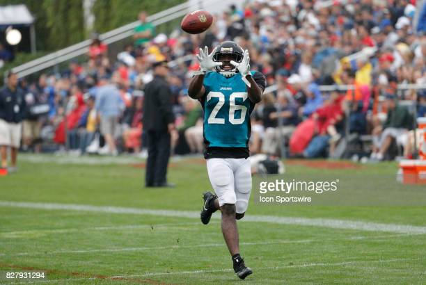 Jacksonville Jaguars cornerback Doran Grant eyes a catch during a joint New England Patriots and Jacksonville Jaguars training camp on August 8 at...
