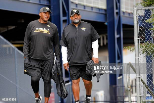 Jacksonville Jaguars defensive line coach Marion Hobby and Jacksonville Jaguars tight ends coach Ron Middleton during a joint New England Patriots...
