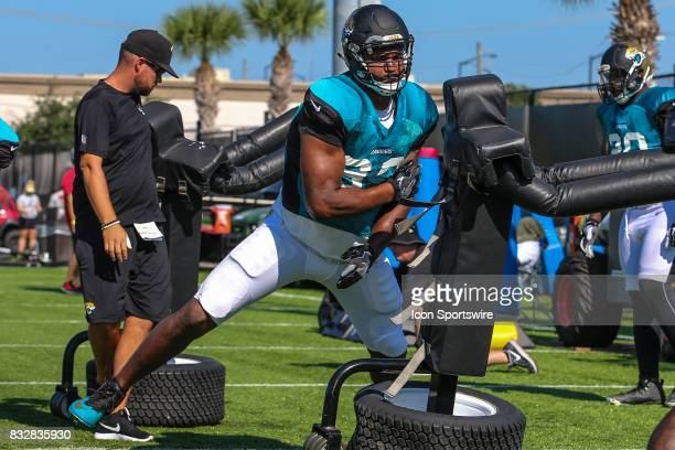 Jacksonville Jaguars defensive lineman Calais Campbell works a practice dummy during the Jaguars joint practice with the Tampa Bay Buccaneers on...