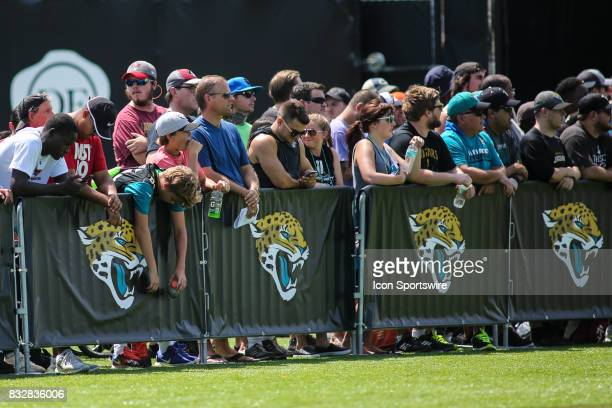 Jacksonville Jaguars fans line the sidelines during the Jaguars joint practice with the Tampa Bay Buccaneers on August 15 2017 at Everbank Field in...