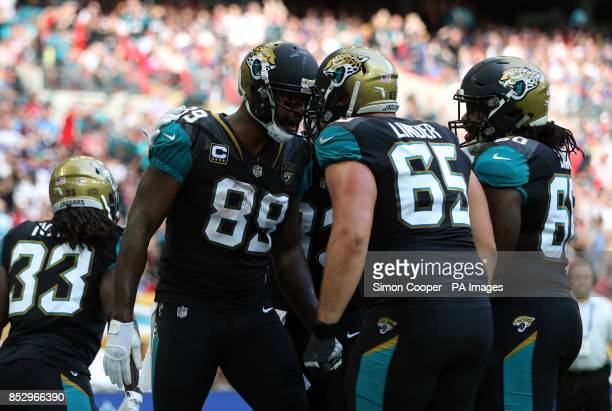 Jacksonville Jaguars Marcedes Lewis celebrates scoring his sides first touchdown of the game with Brandon Linder during the NFL International Series...