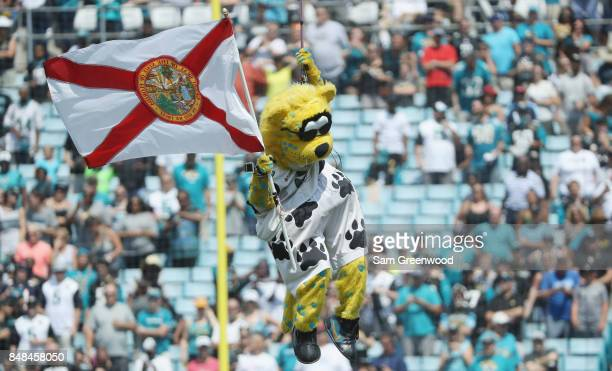Jacksonville Jaguars mascot Jaxson de Ville takes the field with a Florida state flag prior to the start of their game against the Tennessee Titans...