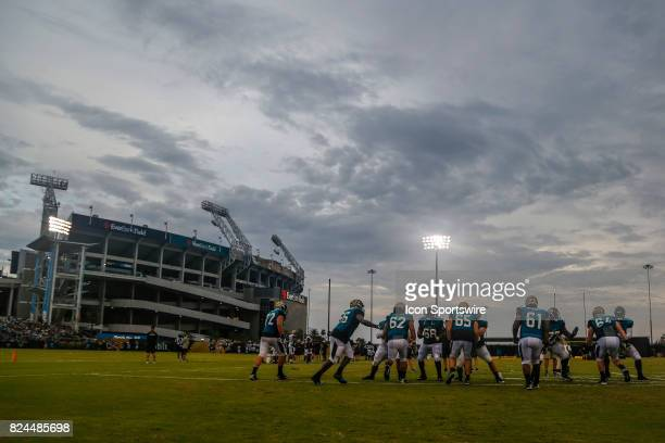 Jacksonville Jaguars offensive linemen practice during the last light of the day during the Jaguars training camp on July 29 2017 at Florida Blue...