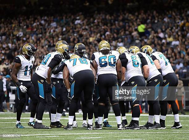Jacksonville Jaguars players huddle up during a game against the New Orleans Saints at the MercedesBenz Superdome on December 27 2015 in New Orleans...