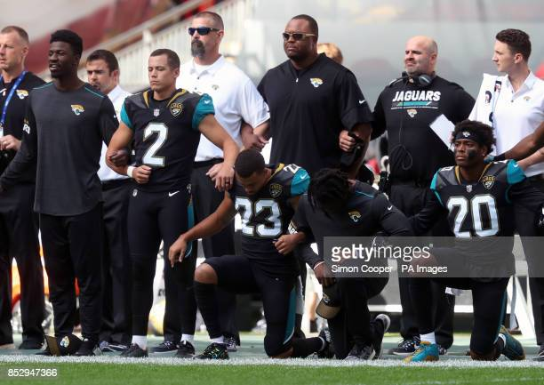 Jacksonville Jaguars players kneel in protest during the national anthem before the NFL International Series match at Wembley Stadium London