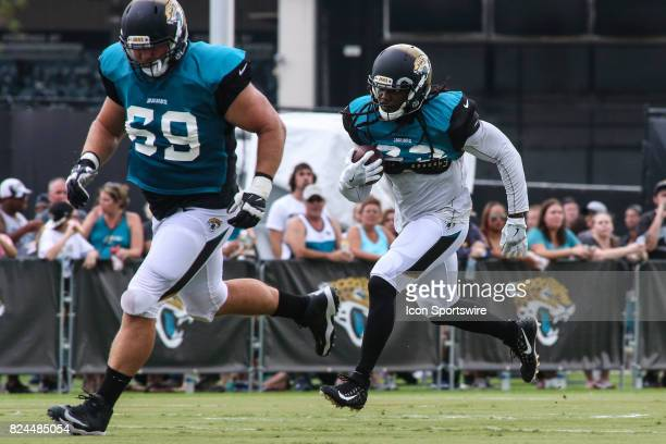 Jacksonville Jaguars running back Chris Ivory runs with the ball during the Jaguars training camp on July 29 2017 at Florida Blue Health and Wellness...