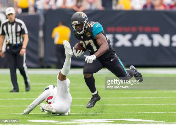 Jacksonville Jaguars running back Leonard Fournette rushes the ball on his way to a 100yard game during the NFL game between the Jacksonville Jaguars...