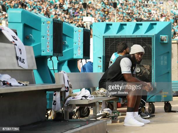 Jacksonville Jaguars running back Leonard Fournette sits on the bench after he was deactivated for Sunday's game against Cincinnati after he violated...