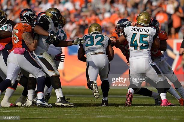Jacksonville Jaguars running back Maurice JonesDrew runs through a hole in the line in the third quarter The Denver Broncos take on the Jacksonville...