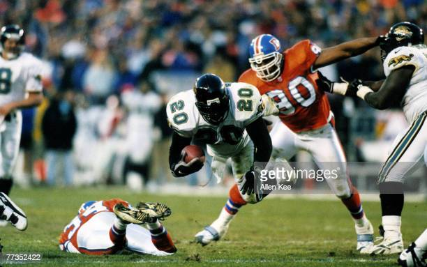 Jacksonville Jaguars running back Natrone Means dives forward for additional yards during the Jaguars 3027 victory over the Denver Broncos in the...