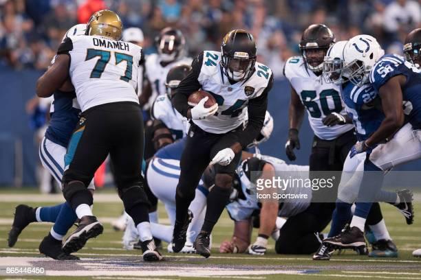 Jacksonville Jaguars running back TJ Yeldon breaks through the line for a 58 yard touchdown during the NFL game between the Jacksonville Jaguars and...