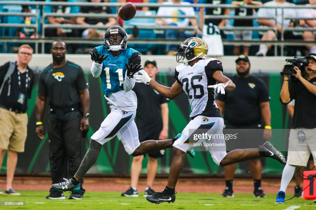 Jacksonville Jaguars wide receiver Marqise Lee (11) catches a pass over Jacksonville Jaguars cornerback Doran Grant (26) during the Jaguars training camp on August 4, 2017 at Everbank Field in Jacksonville, Fl.