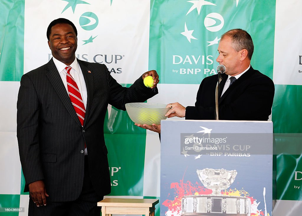 Jacksonville Mayor Alton Brown (L) selects the first match pairings during the Davis Cup Draw ceremony first round between the U.S. and Brazil at the Times-Union Center on January 31, 2013 in Jacksonville, Florida.