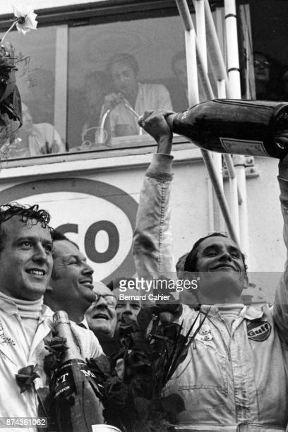 Jacky Ickx Jackie Oliver 24 Hours of Le Mans Le Mans 15 June 1969 Jacky Ickx and Jackie Oliver on the winners podium after their victory in the 1969...