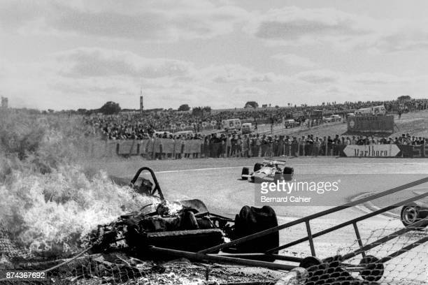 Jacky Ickx Jochen Rindt Ferrari 312B Grand Prix of Spain Circuito del Jarama 19 April 1970 Jochen Rindt goes by the burning Ferrari of Jacky Ickx...