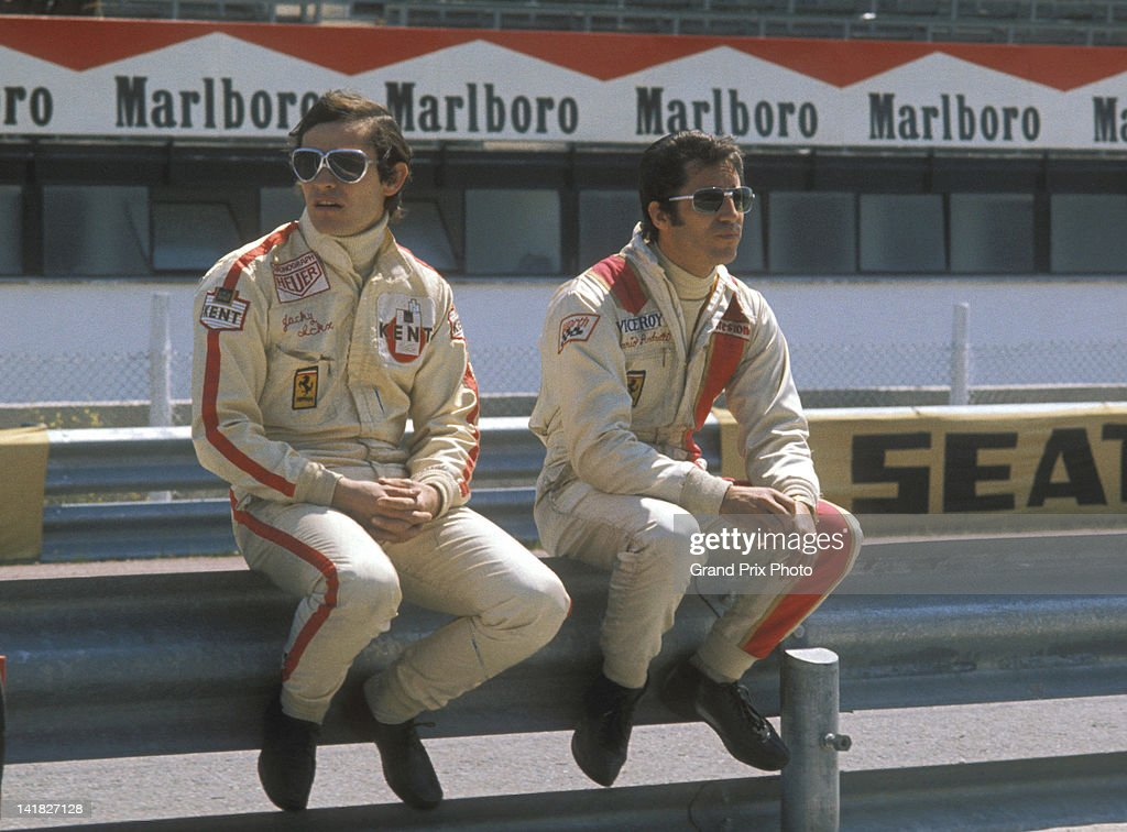 Jacky Ickx of Belgium and Mario Andretti of the United States drivers of the Scuderia Ferrari 312B2 Ferrari F12 in the pits before the start of the...