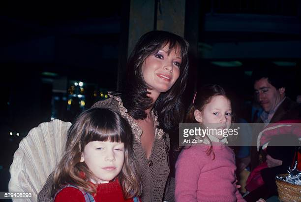 Jaclyn Smith with 2 little girls wearing a taupe sweater circa 1970 New York