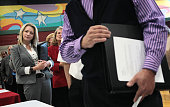 Jaclyn Weitzenfeld waits in line to speak with a company recruiter during a job fair hosted by Illinois State Senator Dan Kotowski and the Illinois...