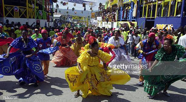 Haitian dancers perform during a the annual Carnival rally 11 February 2007 in Jacmel This Victorian village on Haiti's south coast has the best...