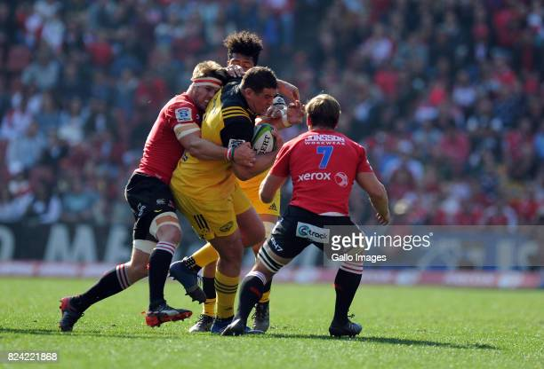 Jaco Kriel and Kwagga Smith of Lions in action with Ben May of Hurricanes during the Super Rugby Semi Final match between Emirates Lions and...