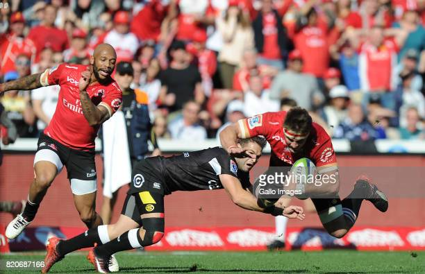 Jaco Kriel and Lionel Mapoeof Lions in action with Cobus Reinach of Sharks during the Super Rugby Quarter final between Emirates Lions and Cell C...