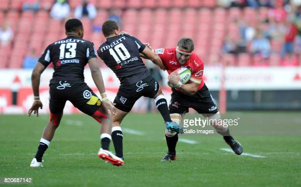 Jaco Kriel of Lions in action with Lukhanyo Am and Curwin Bosch of Sharks during the Super Rugby Quarter final between Emirates Lions and Cell C...
