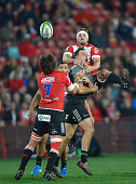Jaco Kriel of the Emirates Lions and Israel Dagg of the Crusaders vie for the ball during the Super Rugby quarter final clash between the Emirates...